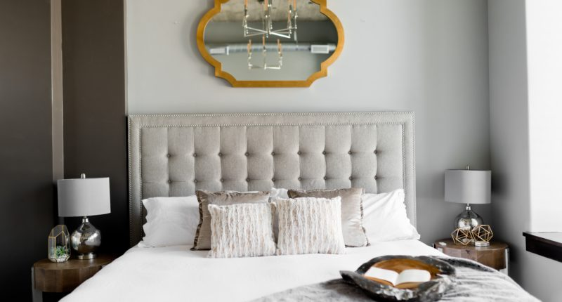 tufted white bed near window