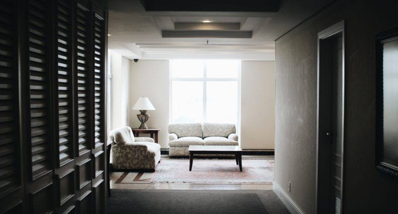 white 2-piece sofa and brown wooden coffee table